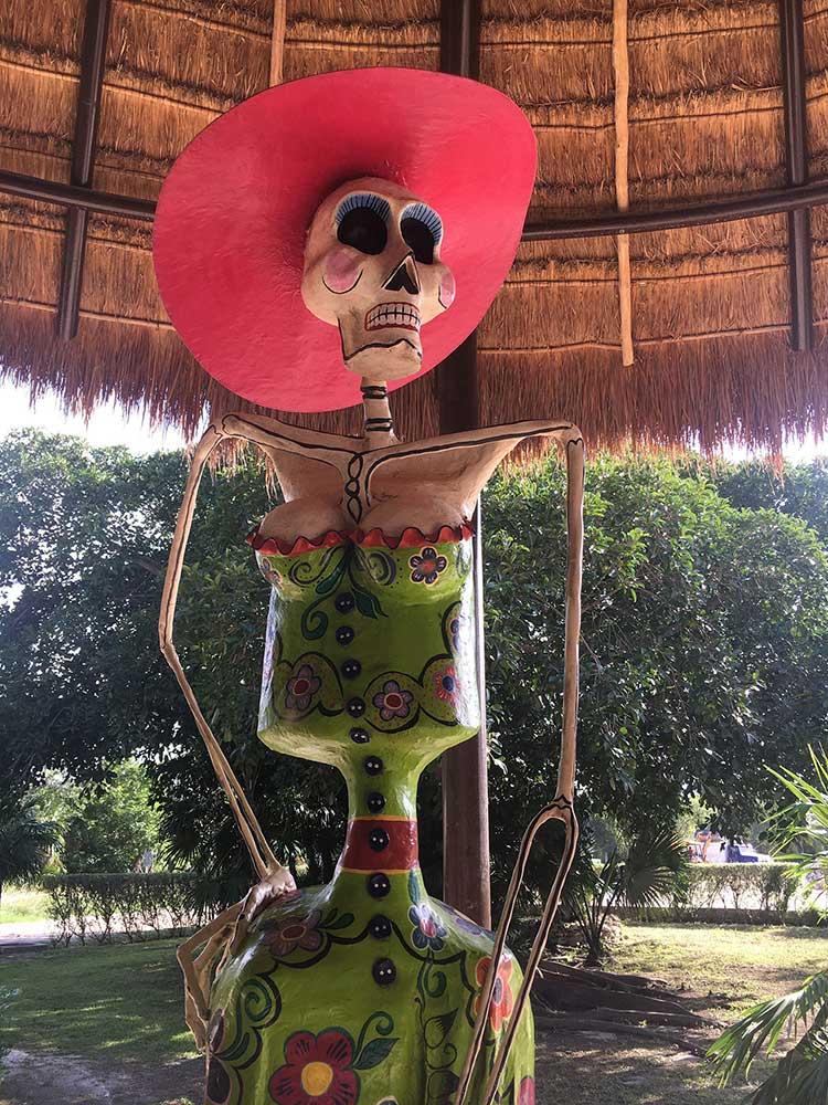 curly nomad mexico tulum skeleton photo