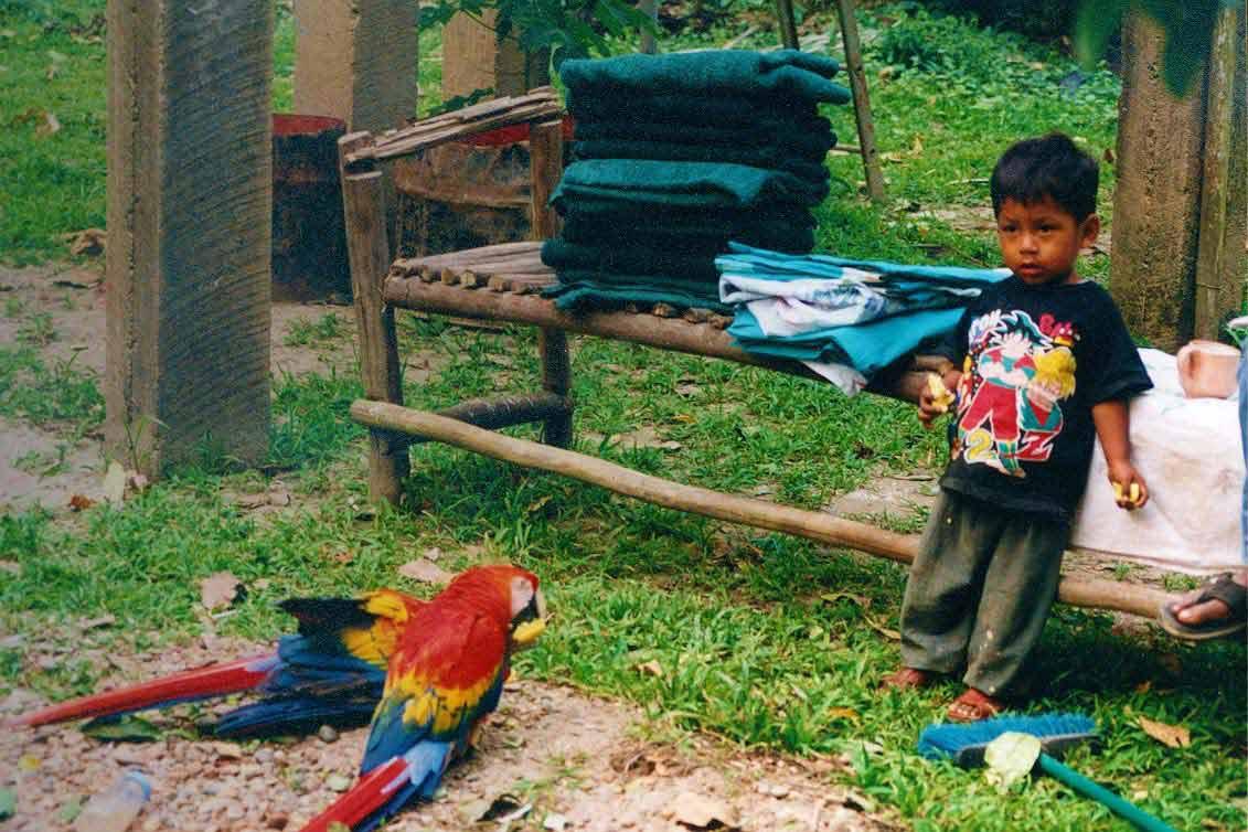 curly nomad peru amazon river boy jungle photo