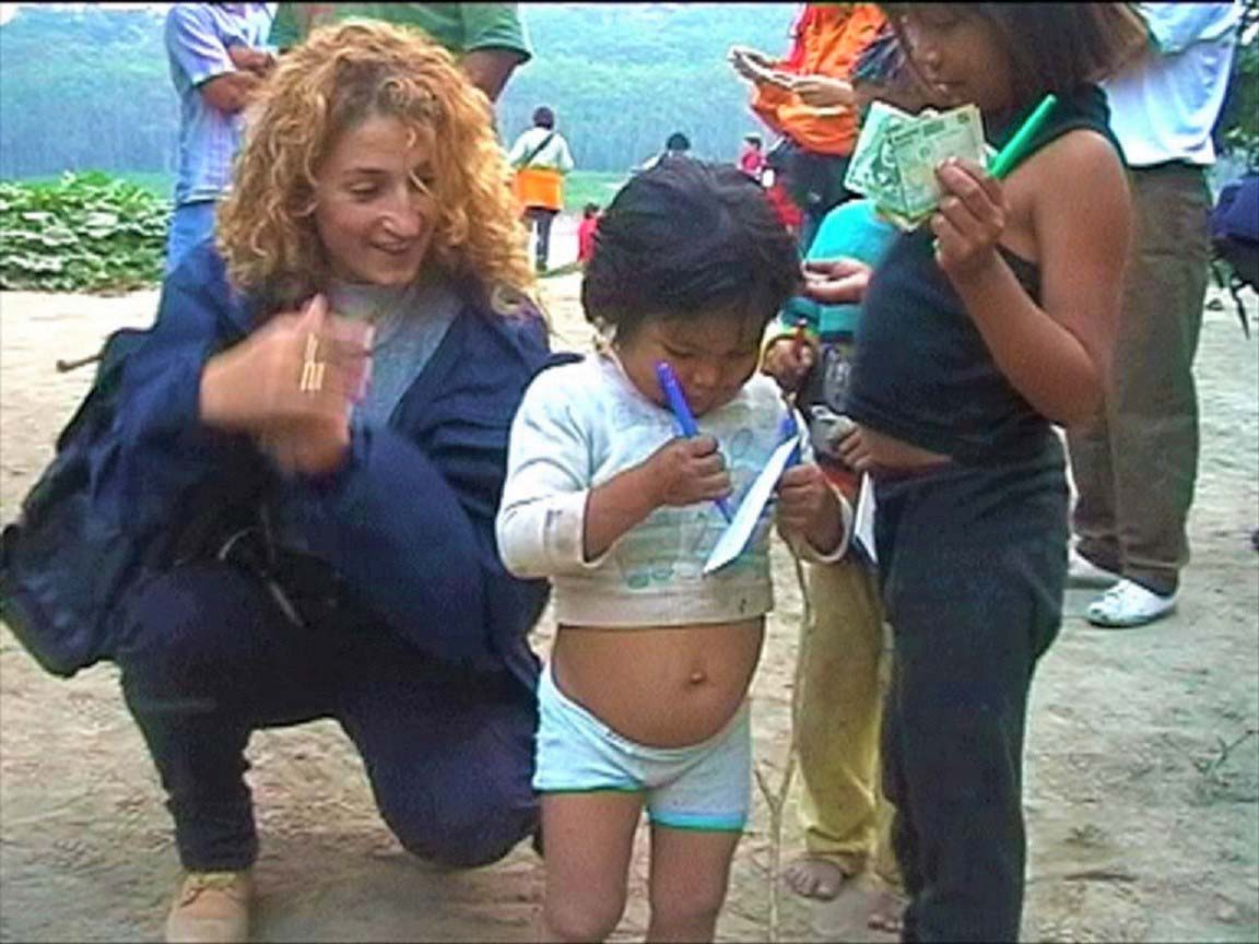 curly nomad peru amazon river little girl painting jungle photo
