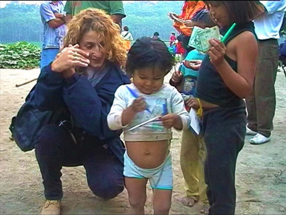 curly nomad peru amazon river little girls jungle house image