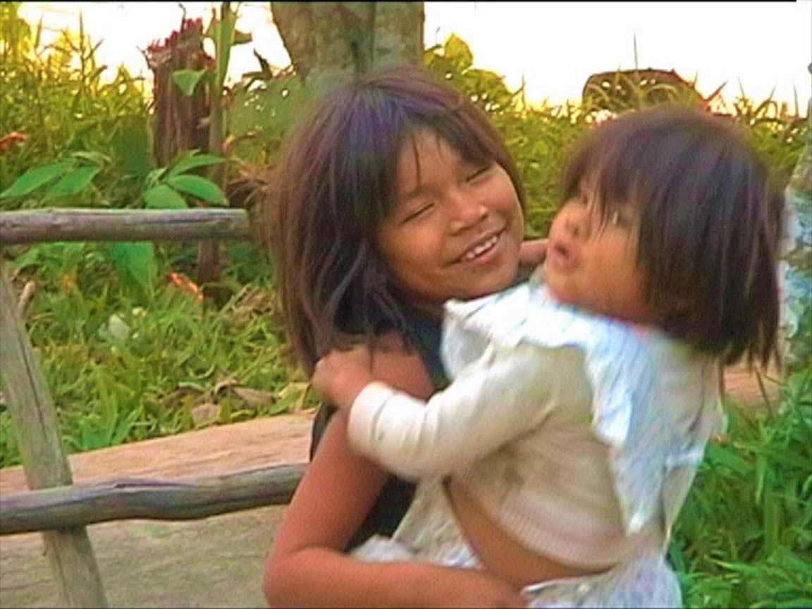 curly nomad peru amazon river madre de dios sisters image