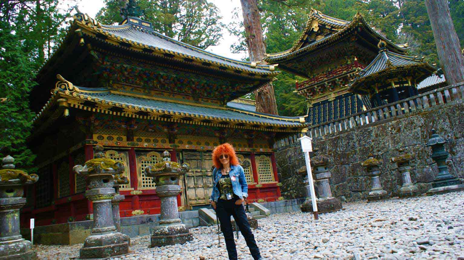 curly nomad asia japan temple smiling photo